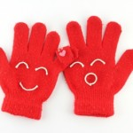 red pairs of gloves