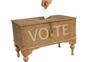 """Hand Dropping The Vote Paper"" by taoty. Image courtesty of FreeDigitalPhotos.net"